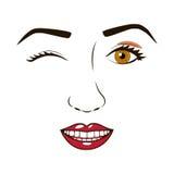 Woman& x27; сторона s подмигивая и усмехаясь Стоковое фото RF