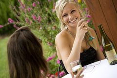 Woman. Model Release 351  Young women relaxing with a glass of wine in an outdoor cafe Royalty Free Stock Images