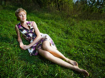 Woman. Wide angle shot of a woman having rest on the grass Royalty Free Stock Image