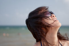 Woman. In the sand beach exposes to the sun insolation's woman Royalty Free Stock Images