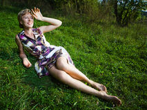 Woman. Wide angle shot of a woman having rest on the grass Stock Images