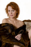 Woman. Portrait of  one beautiful woman in fur coat with Naked shoulders Royalty Free Stock Photography