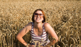 The woman. The woman on the nature, in a wheaten field Stock Images
