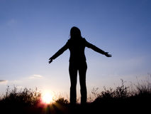 Woman. A silhouette of young girl is on a background sky stock photography