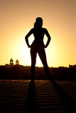 Woman. Silhoutte of a beautiful woman in the sand at sunset royalty free stock images