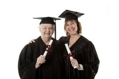 Beauitiful Caucasian mother and daughter in black graduation gowns  Stock Photo