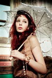 Woman. Young romantic look woman portrait with parasol, indoor shot Royalty Free Stock Photo