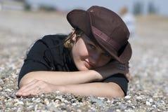 Woman. Young woman lies on a beach Stock Photos