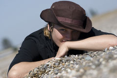 Woman. Young girl in a hat lies on a beach Stock Photo