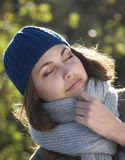 Woman. Young beautiful woman in a cap, eyes are closed Stock Images