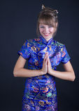 Woman. Young woman in Chinese dress on black background Royalty Free Stock Image