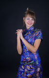 Woman. Young woman in Chinese dress on black background Royalty Free Stock Photography
