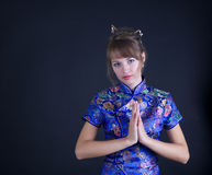 Woman. Young woman in Chinese dress on black background Stock Photography