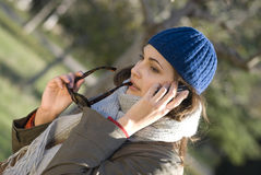 The woman. Young beautiful woman speaks by phone Royalty Free Stock Images