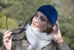 Woman. In a dark blue cap holds points Stock Photography