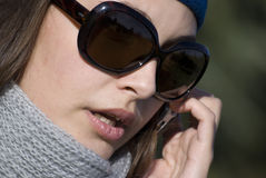 The woman. Young woman in dark glasses speaks on the phone Royalty Free Stock Photos