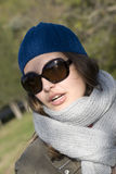 The woman. Beautiful young woman in a dark blue cap and black glasses Royalty Free Stock Images