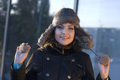 The woman. Young beautiful woman in a cap with ear-flaps Stock Images