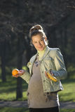The woman. The pregnant woman on the nature in a grey sleeveless jacket Royalty Free Stock Image