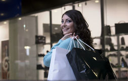 The woman. Young beautiful woman smiling goes shopping Stock Photos