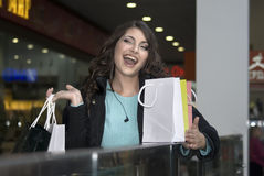 The woman. Young beautiful woman smiling goes shopping Royalty Free Stock Image
