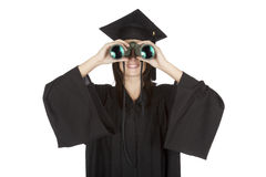 Caucasian woman wearing in a black graduation gown Royalty Free Stock Photos