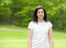 Woman. Pretty woman standing outside on grass portrait Stock Photography