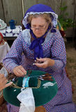 Woman in 19th century costume making bobbin lace Royalty Free Stock Photography