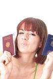 Woman with 2 passports Royalty Free Stock Image