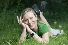 Woman. Young blond woman laughing in the grass stock photo