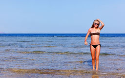 Woman. With sunglasses, standing in the water Royalty Free Stock Photos
