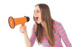 Woman. Portrait of a beautiful brunette woman shouting through megaphone Stock Images