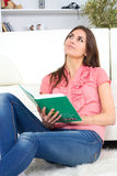 Woman. Beautiful young woman on the couch with a book Royalty Free Stock Photography
