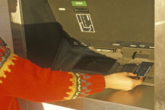 Woman at 24 hour ATM machine Royalty Free Stock Photo