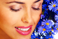 Woman. Smiling pretty woman with blue flowers Royalty Free Stock Photo