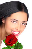 Woman. Smiling pretty woman with a rose. Over white background Royalty Free Stock Photo