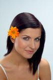 Woman. Portrait of young pretty woman with flowers stock photos