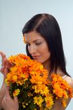 Woman. Portrait of young pretty woman with flowers stock photo