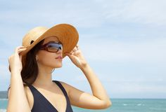 Woman. Portrait of young beautiful woman in straw hat and sunglasses Stock Photography