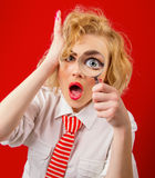 Woman. Amazedly funny woman with magnifier, isolated on red background Stock Images