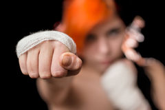 Woman. Yound beautiful redhead colored woman posing as kickboxer in studio, black  background Royalty Free Stock Photos