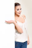 Woman. Young blonde woman standing near white board Royalty Free Stock Image