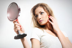Woman. Young blonde woman with mirror Royalty Free Stock Images