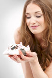 Woman. Young woman holding tiny shoes Royalty Free Stock Photos