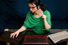 Woman with 3 Laptops Royalty Free Stock Photos