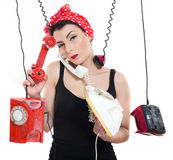 Woman with 3 phones. Woman with red kerchief holding many phones which are hanging Royalty Free Stock Photography