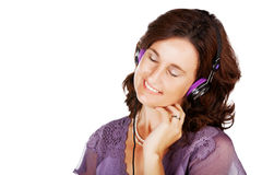 Woman in 30s with earphones Royalty Free Stock Images