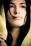 Woman. Young black hair woman portrait with yellow scarf in dark Royalty Free Stock Photos