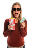 Woman With 3D Glasses. Young woman watching movie with 3D glasses holding popcorn and tickets isolated over white background Royalty Free Stock Photography
