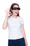 Woman in 3d glasses showing ok sign Stock Image
